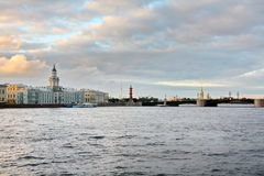 Neva and St. Petersburg in the evening. Cabinet of curiosities, a bridge over the Neva river and Vasilievsky island on the slope of the day Stock Images