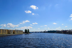 Neva in St. Petersburg. The Neva river is the main river in St. Petersburg. View of Neva river from the bridge. Clouds and blue sky over the river Neva. Houses stock photography