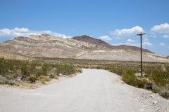 The Nevada Desert. A dirt road running through the Nevada Desert landscape stock image
