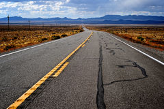 Nevada desert road. Mysterious and lonely road in Nevada desert Royalty Free Stock Photos