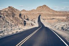 Nevada desert road, USA. Nevada desert road, color toned travel concept picture, USA stock image