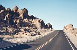 Nevada desert road, USA. Nevada desert road, color toned travel concept picture, USA stock photos
