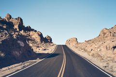 Nevada desert road, USA. Nevada desert road, color toned travel concept picture, USA royalty free stock photo