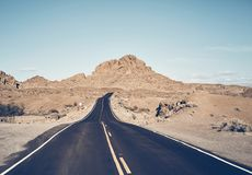 Nevada desert road, USA. Nevada desert road, color toned travel concept picture, USA stock photography