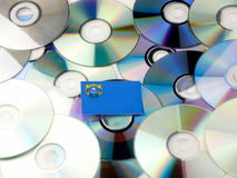 Nevada flag on top of CD and DVD pile  on white Stock Photography
