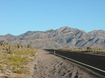 Nevada Highway, 2005. Deserted highway in a Nevada summer afternoon Stock Images