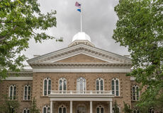 Nevada State Capitol Building. Flags flying over the Nevada Capitol Building in Carson City Royalty Free Stock Photography