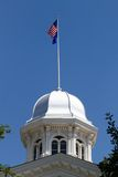 Nevada State Capitol Dome. Located in Carson City, NV against a blue sky background with flags flying on top Royalty Free Stock Photos