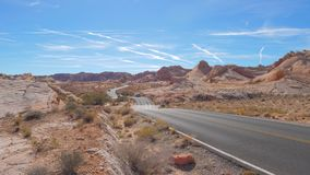 Nevada, USA-November 08,2017: Cars Driving On A Winding Road In Red Rock Park. Nevada, USA-November 08,2017: Cars driving on a winding road in the Red Rock Park stock video footage