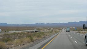 Nevada, USA-November 07,2017: Trucks Driving On The Highway In The Desert. Nevada, USA-November 07,2017: Long trucks go on the road in the desert, one after stock video
