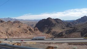 Nevada, USA-November 07,2017: Trucks Driving On The Highway In The Desert. Nevada, USA-November 07,2017: Trucks go on the road in the desert, one after another stock video footage
