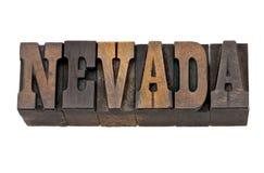 Nevada - Zustandsname in der Briefbeschwererholzart Lizenzfreie Stockfotografie
