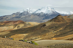 Nevado de Putre and colorful mountain views from Cerro Milagro. Lauca national park, Chile Stock Photo