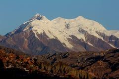 Nevado Illimani. 6400 m high Nevado Illimani towering over the city of La Paz in Bolivia Stock Image