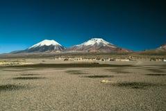 Nevado Sajama. Scenic view of bolivian volcanoes,Pomerape and Paranicota in Sajama national park Royalty Free Stock Photography