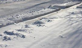A neve arou a estrada Imagem de Stock