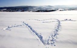 Neve branca com forma do coração Imagem de Stock Royalty Free