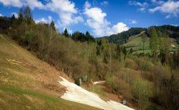 Neve che scompare nelle alpi austriache Fotografia Stock