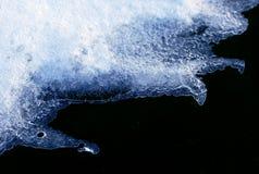 Neve de derretimento e terra preta Imagem de Stock