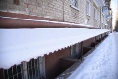 Neve del tetto Fotografie Stock