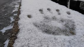 Neve della stampa della mano Fotografie Stock Libere da Diritti