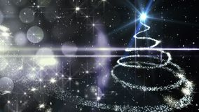 Neve di caduta con i cerchi e l'albero di Natale della luce del bokeh video d archivio