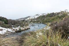 Neve do córrego da estrada do deserto, Mt Ruapehu, Nova Zelândia Imagem de Stock