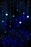 A neve e as estrelas estão caindo no fundo do bl Fotografia de Stock Royalty Free