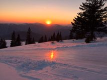 Neve e por do sol Imagem de Stock Royalty Free