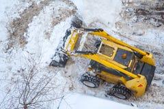 Neve-eliminazione della neve a macchina delle pale Immagini Stock Libere da Diritti