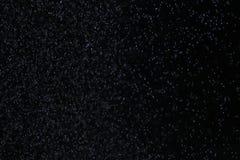 Neve em um fundo preto Imagens de Stock