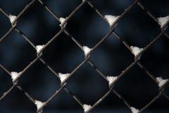 Neve em uma cerca da ligação chain Fotografia de Stock