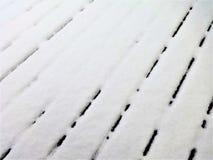 Neve em uma plataforma de madeira Imagem de Stock Royalty Free
