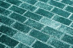Neve na textura do pavimento no tom ciano imagem de stock