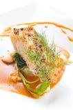 Neve-peixes grelhados com molho da lagosta Fotos de Stock Royalty Free