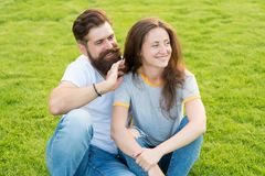Never boring. summer relax in park. family weekend. cute girl and bearded man hipster on green grass. fashion couple royalty free stock photography