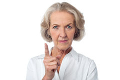 Never do this again, ever!. Angry aged woman warning you Stock Photos