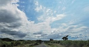 The Never Ending Highway Under the Billowy Clouds. Big Island, Naalehu, Hawaii Stock Images