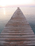 Never ending pier. Wooden pier into the ocean Royalty Free Stock Image