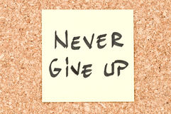 Never Give Up. Handwritten on a sticky note Royalty Free Stock Photography