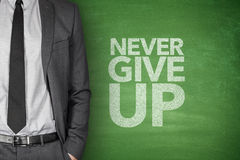 Never give up blackboard. Never give up on blackboard with businessman Stock Image