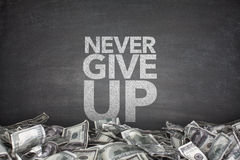 Never give up blackboard Royalty Free Stock Photo