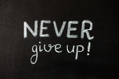 Never give up, business or school motivational words. Stock Photos