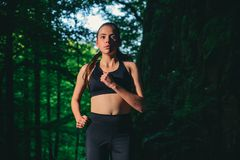 Never give up and keep moving. sporty woman training in green forest. Sport success. Fitness woman with good athlete stock image