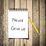Never give up message on Notebook Stock Photos