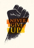 Never Give Up Motivation Poster Concept. Creative Grunge Fist Vector Design Element On Stain Background Royalty Free Stock Photo