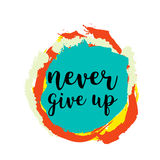Never give up motivational quote on colorful grunge stain.  Royalty Free Stock Images