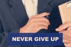 Never give up quotes - Business man background Stock Photo