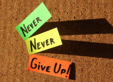 Never give up!. Sticky notes forming text - Never give up Royalty Free Stock Images