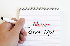 Never give up text concept on notebook. Never give up text concept write on notebook royalty free stock photography